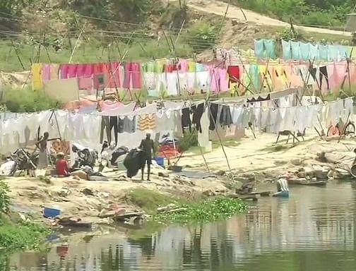 लॉकडाउन में खत्म हुआ धोबी घाट का सूनापन, लेकिन संक्रमण के भय से जारी है धोबियों की मुश्किलें