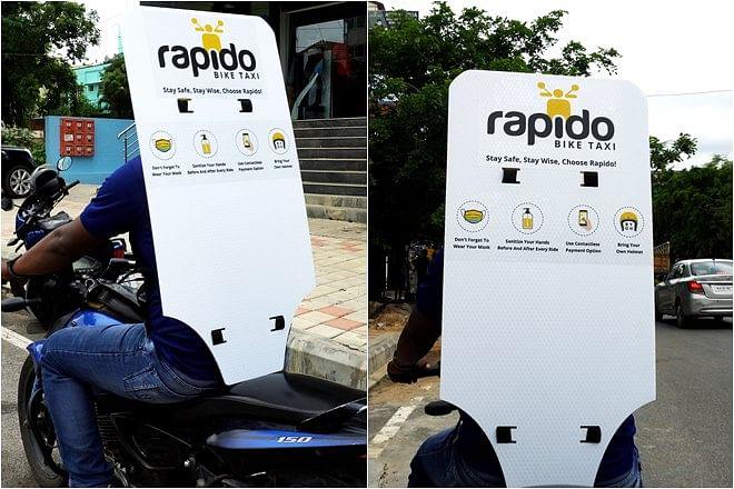 Rapido ने सोशल डिस्टेंसिंग के लिए अपनाया अनोखा तरीका, बाइक पर लगा दी बैक शील्ड