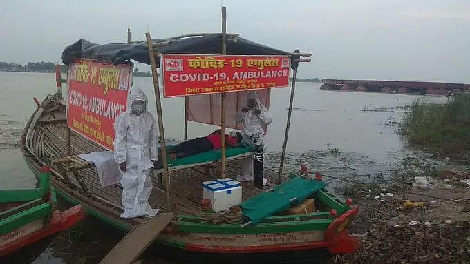 Coronavirus in Bihar: बाढ़ में फंसे कोरोना मरीजों को अस्पताल ले जाने के लिए बोट एंबुलेंस तैनात