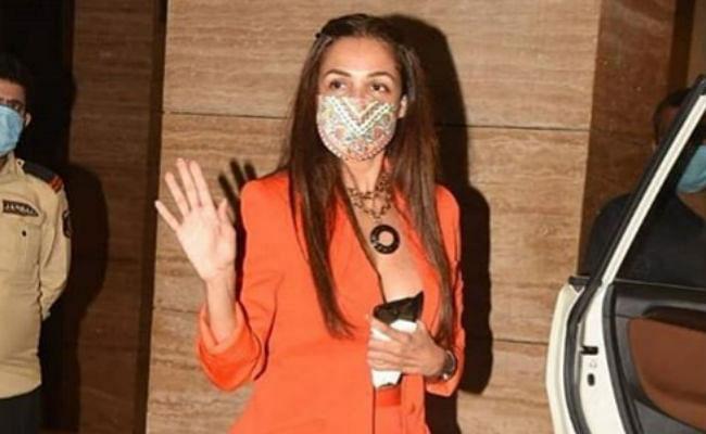 मलाइका अरोड़ा ने ऑरेंज सूट में दिखाया बोल्ड अवतार, अर्जुन कपूर के कैप्शन ने खींचा ध्यान, यहां देखें VIDEO