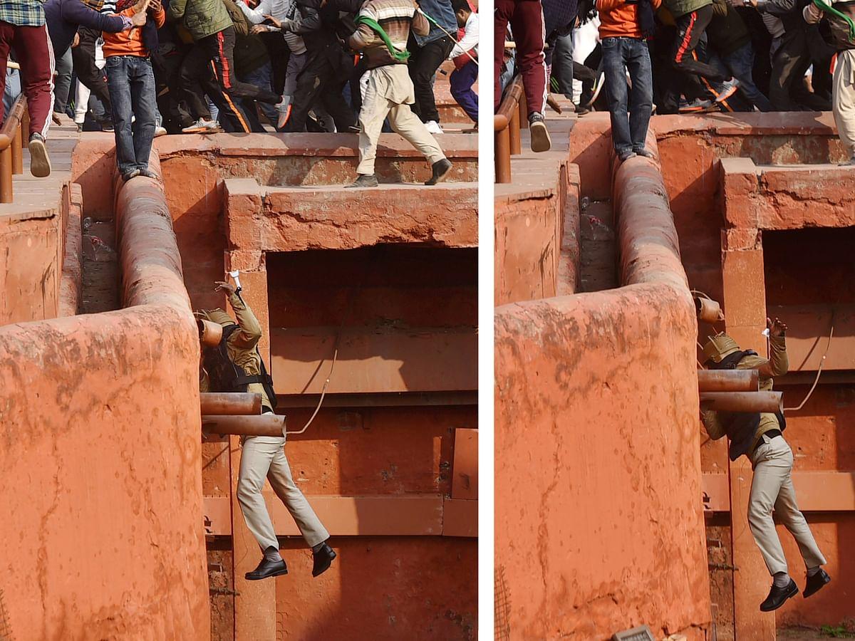 जब हंगामा करने वालों से बचने के लिए दीवार से कूदने लगे पुलिस वाले, VIDEO वायरल
