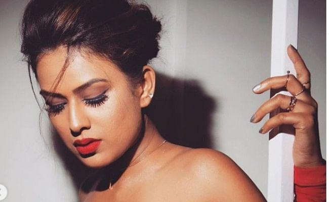 निया शर्मा ने रेड बॉडीकॉन ड्रेस में कराया बोल्ड फोटोशूट, फैंस ने कमेंट में लिखा, हॉट नागिन...