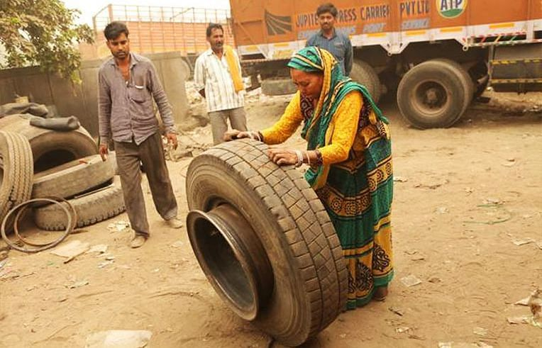 Shanti Devi fixing tyres