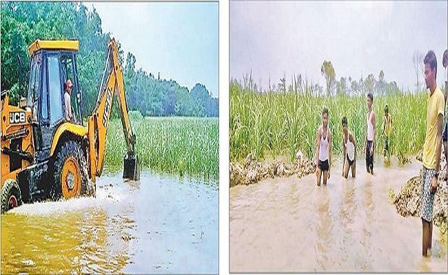 सरकारी तंत्र हुए फेल तो किसानों ने खुद निकाला रास्ता, सैकड़ों एकड़ में लगे गन्ना फसल को बर्बाद होने से बचाया