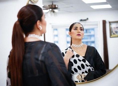 Sapna Chaudhari latest photos in black polka dot saree goes viral on social media