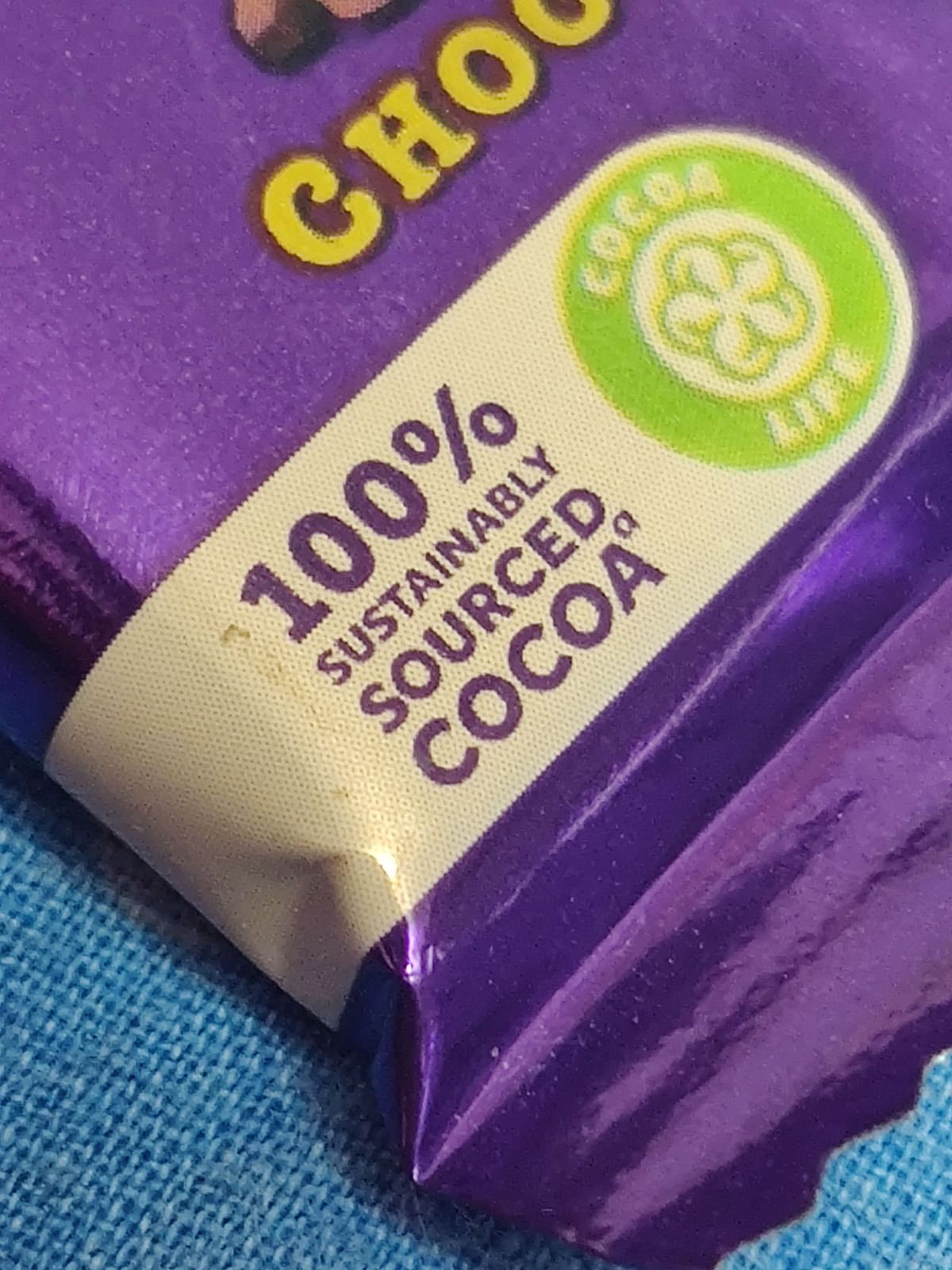 Cadbury Dairy Milk wrapper bears '100% sustainably sourced cocoa' tag