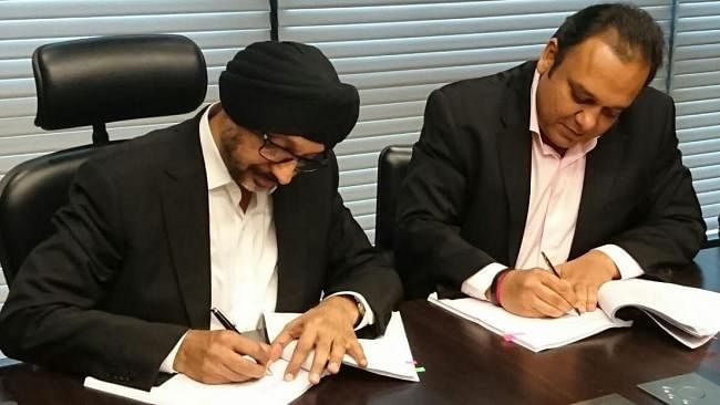 File image of NP Singh and Punit Goenka signing the Ten Sports deal
