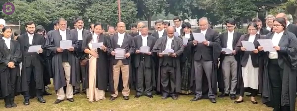 Lawyers gather on Supreme Court lawns to read the Preamble to the Constitution