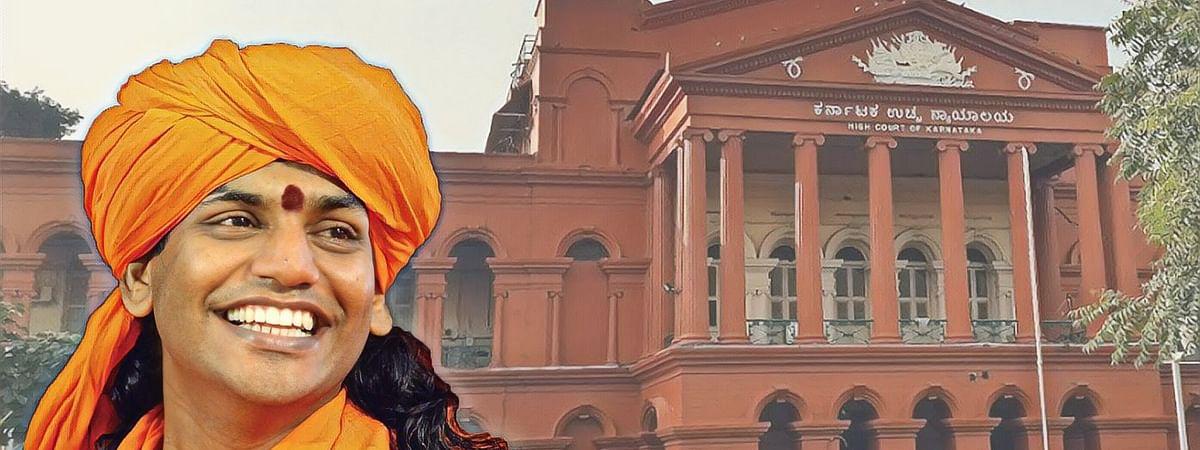"Police claims Nithyananda is on a ""spiritual tour""; Karnataka HC reserves order in plea seeking cancellation of Godman's bail"