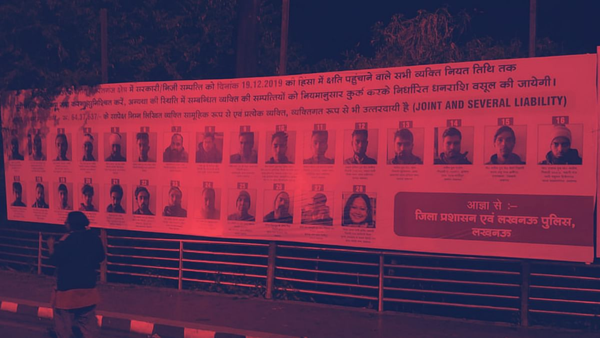 Banners displaying photographs of accused persons