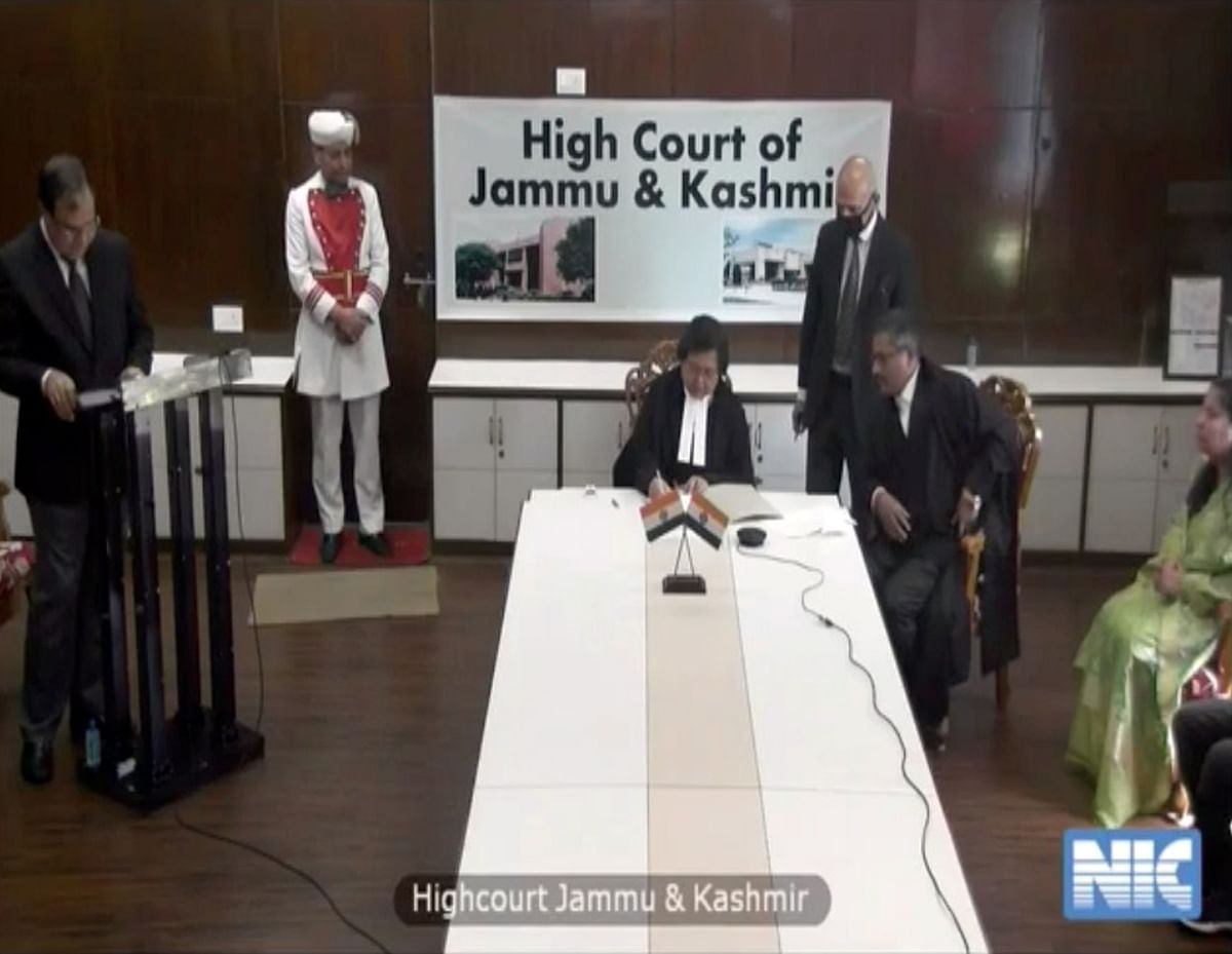 Justice Rajnesh Oswal becomes the first Jammu & Kashmir High Court Judge to take oath under the Indian Constitution