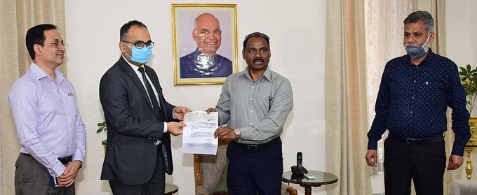J&K LG GC Murmu hands over a cheque for Rs 1 Crore to the Registrar General of the J&K High Court