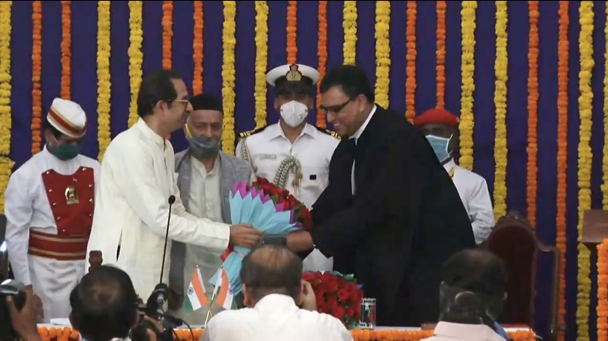 Chief Minister Uddhav Thackeray (L) felicitates Chief Justice Dipankar Datta (R). Governor Bhagat Singh Koshyari pictured in the middle.