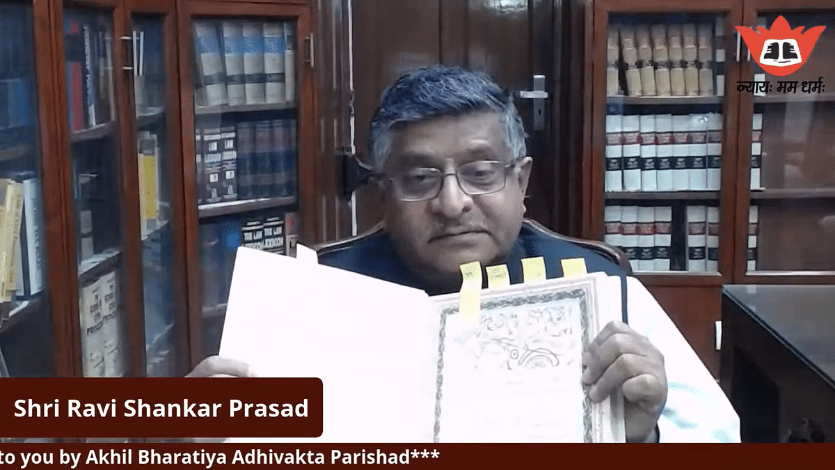 """Ravi Shankar Prasad showing the """"pictures of heritage of India"""" in the original Consitution."""