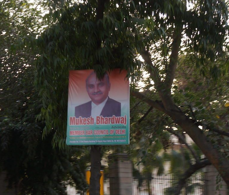 <em><strong>Banners have been installed by candidates on roads leading to the High Court</strong></em>