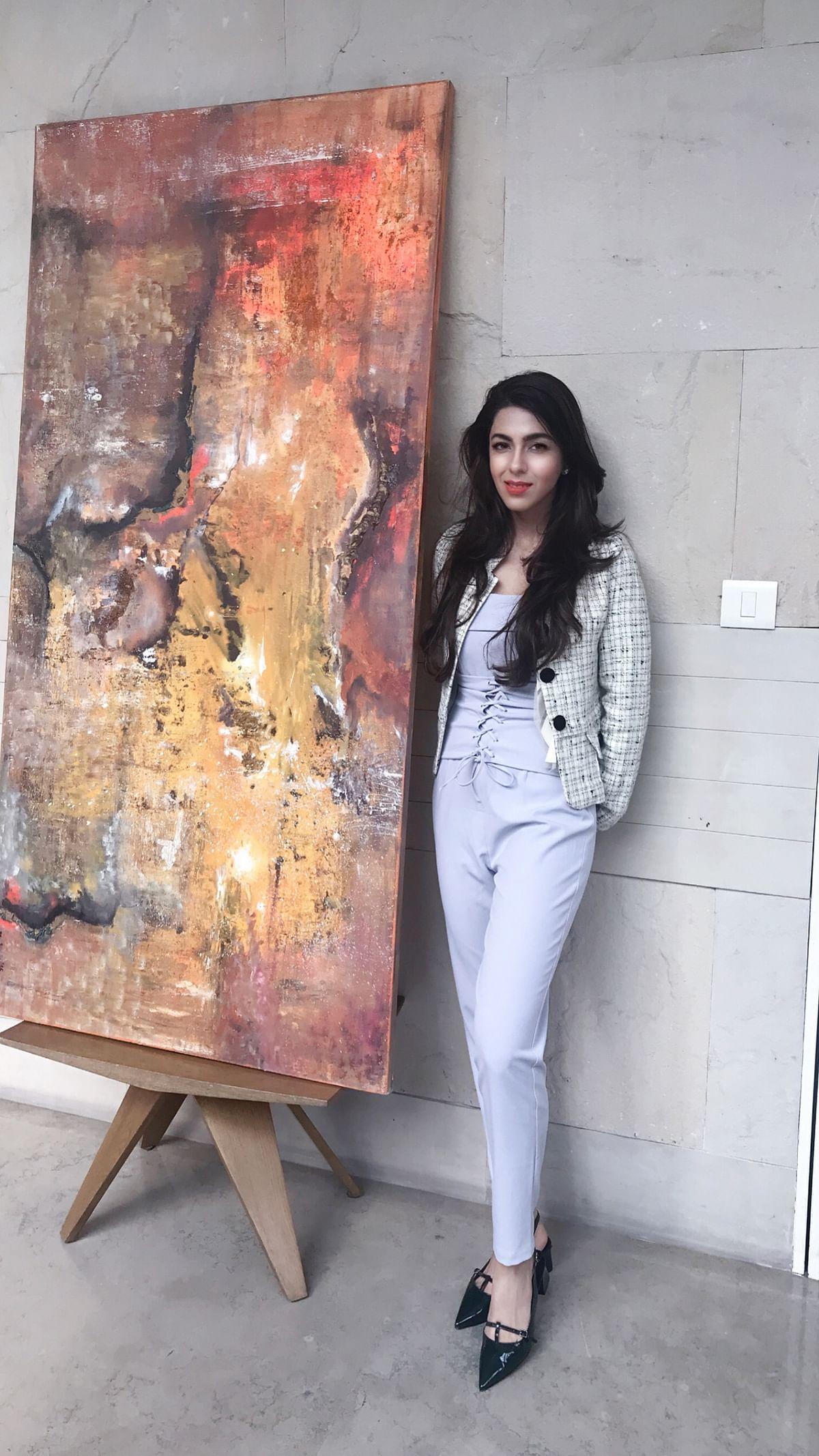 Bahaar Dhawan Rohtagi alongside one of her works