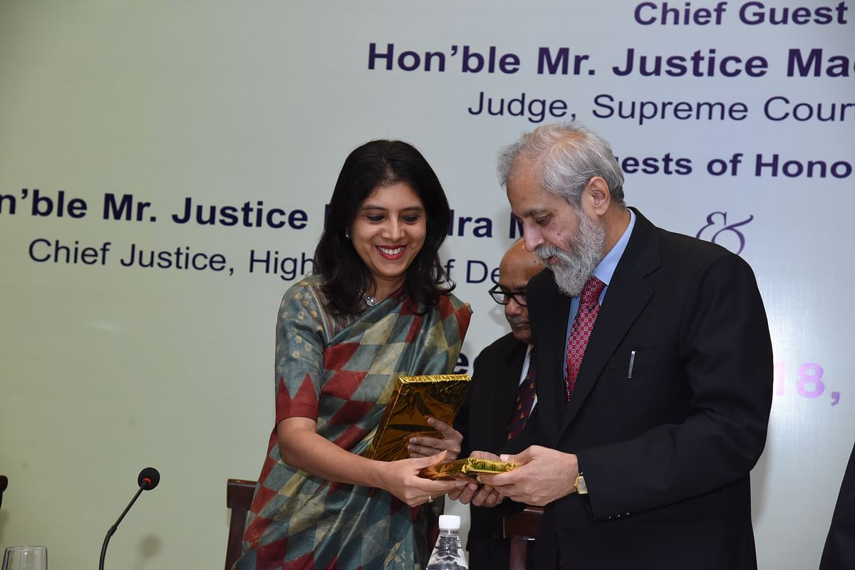 Justiec Madan Lokur of the Supreme Court handed a copy of the issue by Madhavi Divan