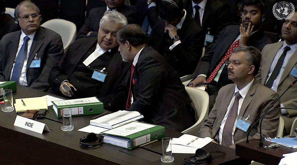 Senior Advocate Harish Salve speaks to Ambassador Venu Rajamony during the hearing