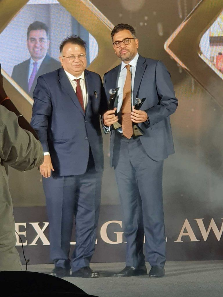 Akshay Chudasama receiving the award for Managing Partner of the Year from Justice AP Shah