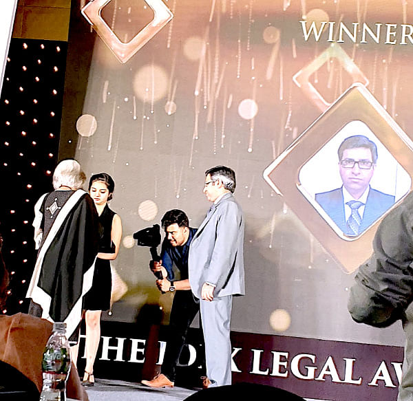 Sameer Chugh, Bharti Airtel collects the award from Senior Advocate Indira Jaising