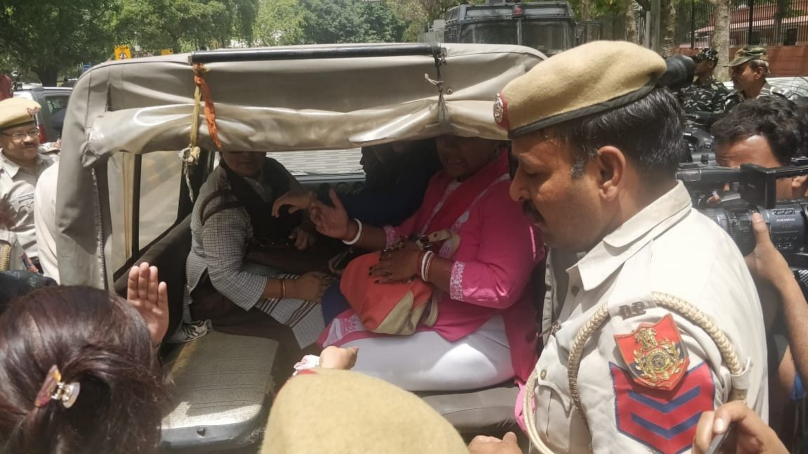 Women protesting outside the Supreme Court being arrested by the police