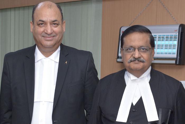 Justice SJ Mukhopadhyay and Justice Bansi Lal Bhat