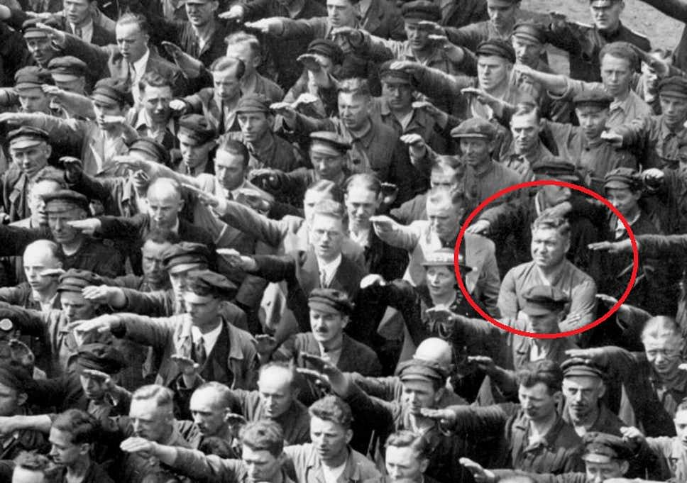 """The image of August Landmesser used by Hegde (Image courtesy:<span style=""""color: #993366;""""><a href=""""https://www.independent.co.uk/news/world/europe/the-tragically-powerful-story-behind-the-lone-german-who-refused-to-give-hitler-the-nazi-salute-a7214386.html"""" rel=""""noopener noreferrer"""" style=""""color: #993366;"""" target=""""_blank""""> Independent, UK</a></span>)"""