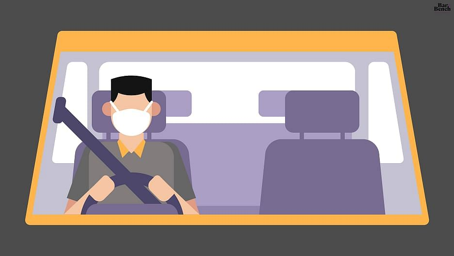 person sitting in a car with mask