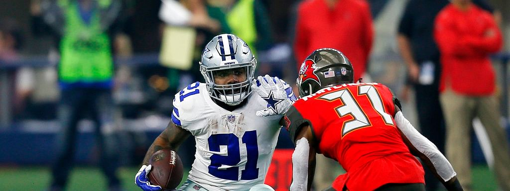 File-This Dec. 23, 2018, file photo shows Dallas Cowboys running back Ezekiel Elliott (21) attempting to evade a tackle by Tampa Bay Buccaneers safety Jordan Whitehead (31) after Elliott caught a pass in the first half time of an NFL football game in Arlington, Texas. Elliott leads NFL with 1,434 yards rushing and 2,001 yards from scrimmage. He is looking for ninth straight game with 100 yards from scrimmage. (AP Photo/Roger Steinman, File)