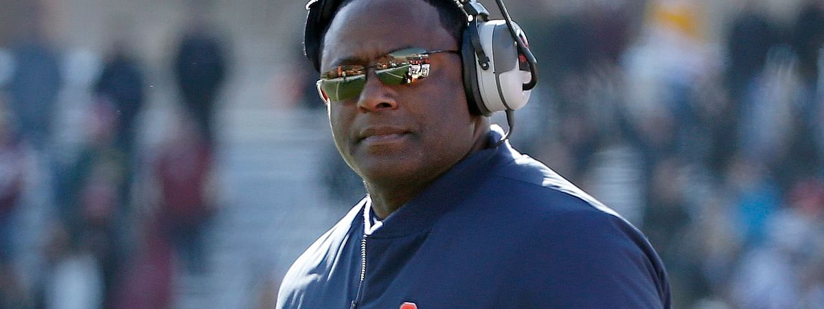 FILE- In this Nov. 24, 2018 file photo, Syracuse head coach Dino Babers looks on during the first half of an NCAA college football game against Boston College, Saturday in Boston. Babers has transformed Syracuse into a winner in three years at the helm. The Orange, who have won nine games and are ranked No. 17, meet No. 15 West Virginia on Friday, Dec. 28, 2018 in the Camping World Bowl. Babers, who just inked a contract extension, feels this is the start of sustained success that could lead to greater heights. (AP Photo/Mary Schwalm, File)