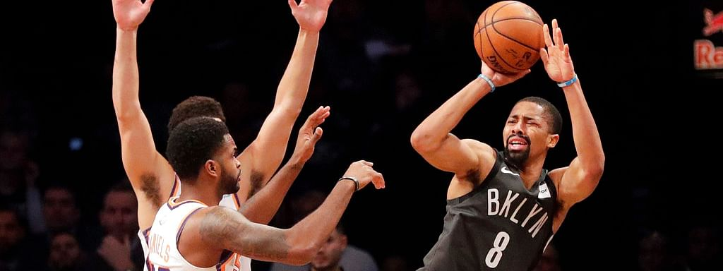 Brooklyn Nets' Spencer Dinwiddie (8) defends against Phoenix Suns' Devin Booker (1) during the first half of an NBA basketball game Sunday, Dec. 23, 2018, in New York. (AP Photo/Frank Franklin II)