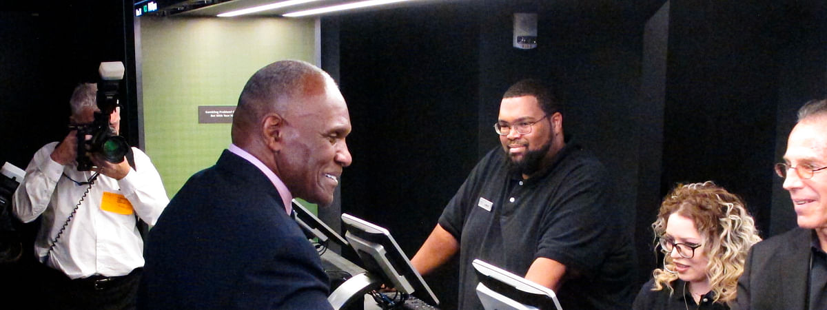 FILE - In this Nov. 20, 2018 file photo, former New York Giants linebacker Harry Carson places a bet on the New York Yankees to win the 2019 World Series at Resorts Casino in Atlantic City, N.J. The race to legalize sports betting is on now that the U.S. Supreme Court has allowed it in all 50 states, but will it provide enough extra tax revenue to make much of a difference for schools, roads or pension debt? (AP Photo/Wayne Parry)
