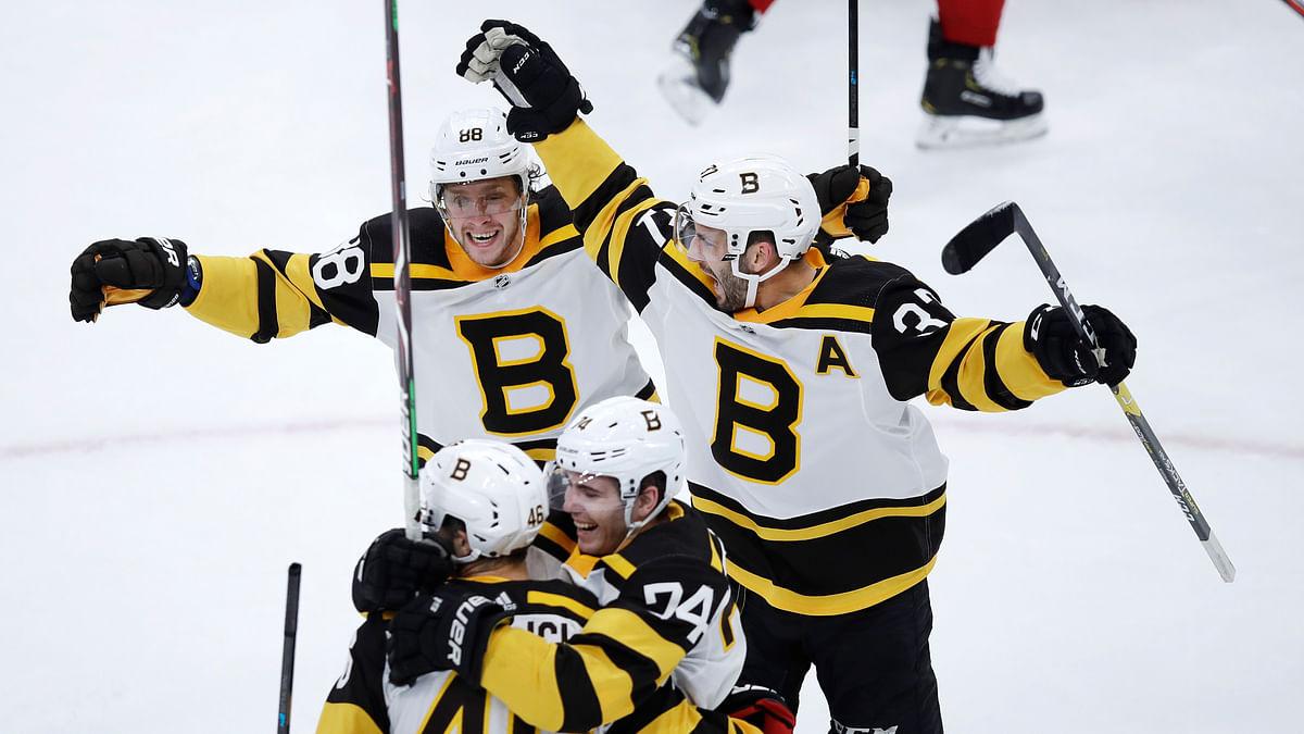 The Boston Bruins celebrate a goal.