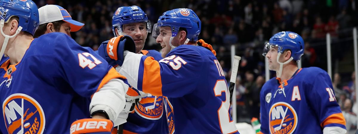 New York Islanders' Devon Toews celebrates with teammates after scoring the game winning goal in the overtime period of an NHL hockey game Thursday, Jan. 3, 2019, in Uniondale, N.Y. The Islanders won 3-2. (AP Photo/Frank Franklin II)