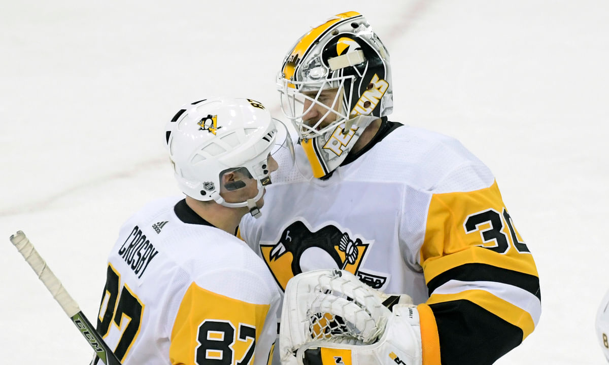 In this January 2019 file photo, Pittsburgh Penguins goaltender Matt Murray (30) celebrates with Sidney Crosby (87) after the Penguins defeated the New York Rangers 7-2 in an NHL hockey game at Madison Square Garden in New York.