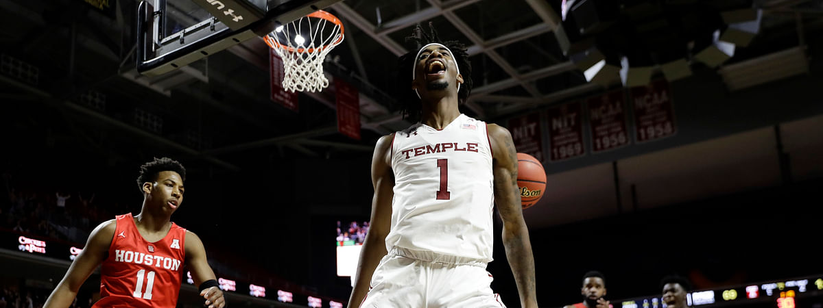 In this Jan 2019 file photo, Temple's Quinton Rose celebrates after a dunk during the second half of an NCAA college basketball game against Houston in Philadelphia.