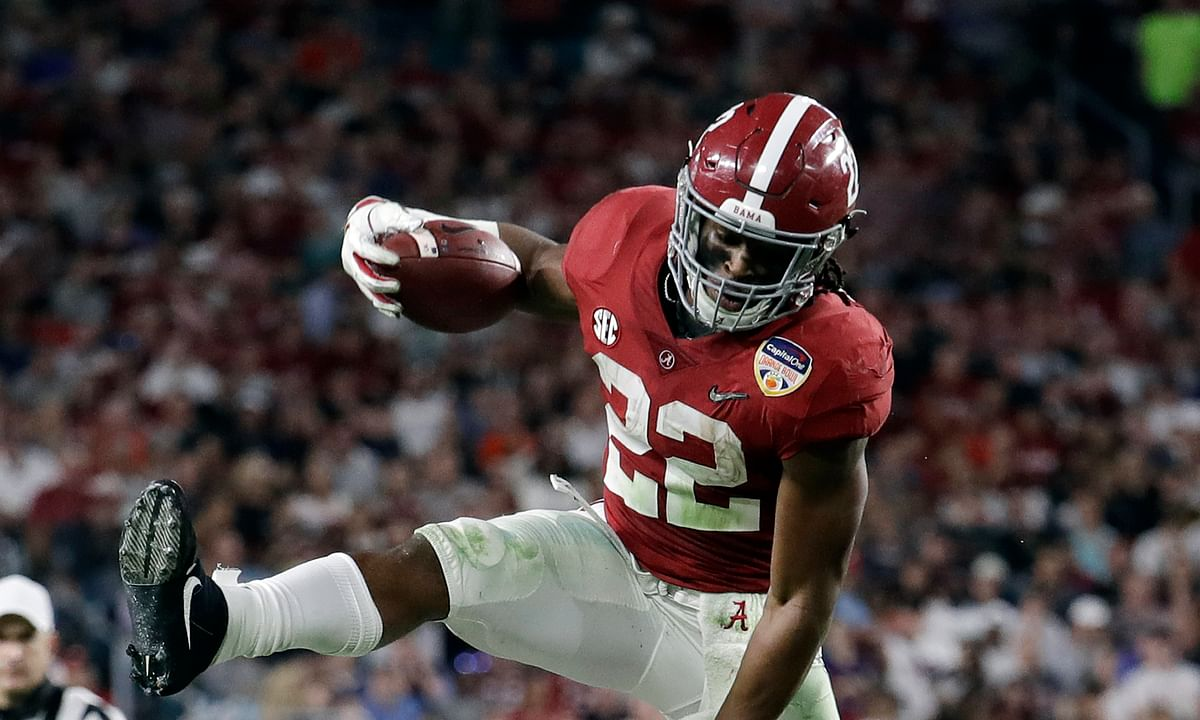 This Dec. 29, 2018, file photo shows Alabama running back Najee Harris (22) jumping over Oklahoma safety Patrick Fields (10), during the first half of the Orange Bowl NCAA college football game, Saturday, Dec. 29, 2018, in Miami Gardens, Florida.
