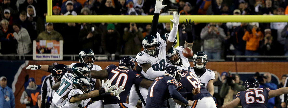 FILE- In this Jan. 6, 2019, file photo, Chicago Bears kicker Cody Parkey (1) boots a field goal-attempt during the second half of an NFL wild-card playoff football game against the Philadelphia Eagles in Chicago. Eagles' Treyvon Hester (90) tipped Parkey's attempt just enough to send the ball bouncing off the upright and crossbar, securing a 16-15 win at Chicago in the wild-card round. (AP Photo/David Banks, File)
