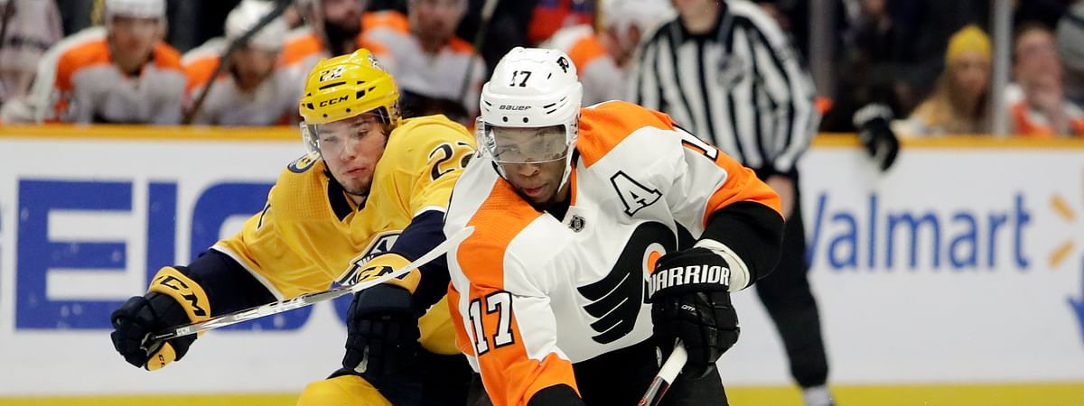 Philadelphia Flyers right wing Wayne Simmonds (17) moves the puck ahead of Nashville Predators left wing Kevin Fiala (22), of Switzerland, during the first period of an NHL hockey game Tuesday, Jan. 1, 2019, in Nashville, Tenn. (AP Photo/Mark Humphrey)