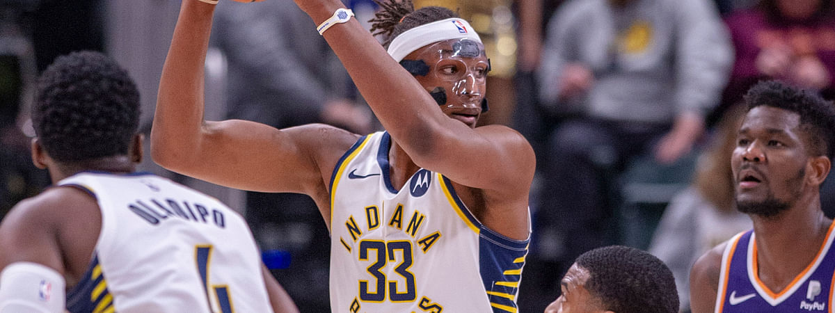 Indiana Pacers center Myles Turner (33) keeps the ball from Phoenix Suns' De'Anthony Melton (14) during the first half of an NBA basketball game Tuesday, Jan. 15, 2019, in Indianapolis. (AP Photo/Doug McSchooler)