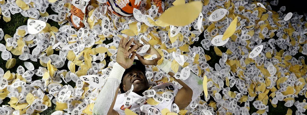 Clemson's Travis Etienne celebrates after the NCAA college football playoff championship game against Alabama, Monday, Jan. 7, 2019, in Santa Clara, Calif. Clemson beat Alabama 44-16. (AP Photo/David J. Phillip)