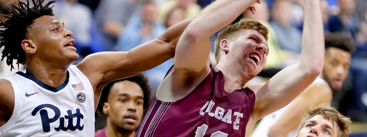 Colgate's Will Rayman (10) gets a rebound in front of Pittsburgh's Au'Diese Toney (5) during the first half of an NCAA college basketball game, Saturday, Dec. 29, 2018, in Pittsburgh. (AP Photo/Keith Srakocic)