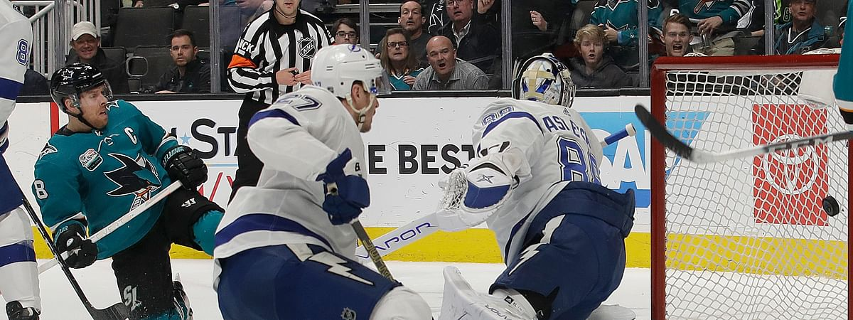 San Jose Sharks center Joe Pavelski, left, scores a goal past Tampa Bay Lightning goaltender Andrei Vasilevskiy, from Russia, right, during the first period of an NHL hockey game in San Jose, Calif., Saturday, Jan. 5, 2019. (AP Photo/Jeff Chiu)