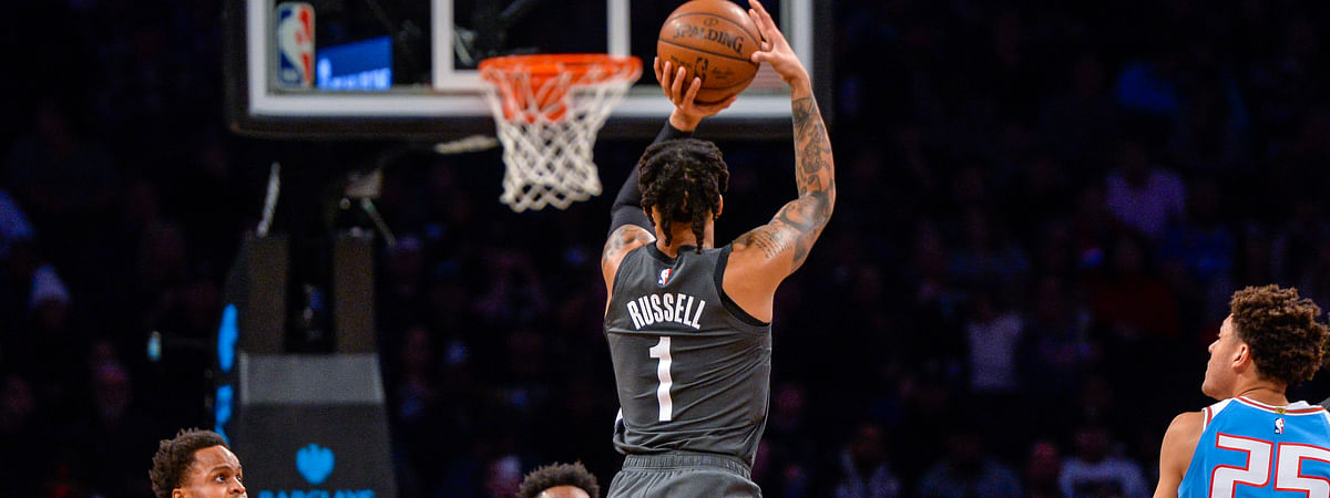 Brooklyn Nets guard D'Angelo Russell (1) shoots a jumper during the first half of an NBA basketball game against the Sacramento Kings, Monday, Jan. 21, 2019, in New York. (AP Photo/Howard Simmons)
