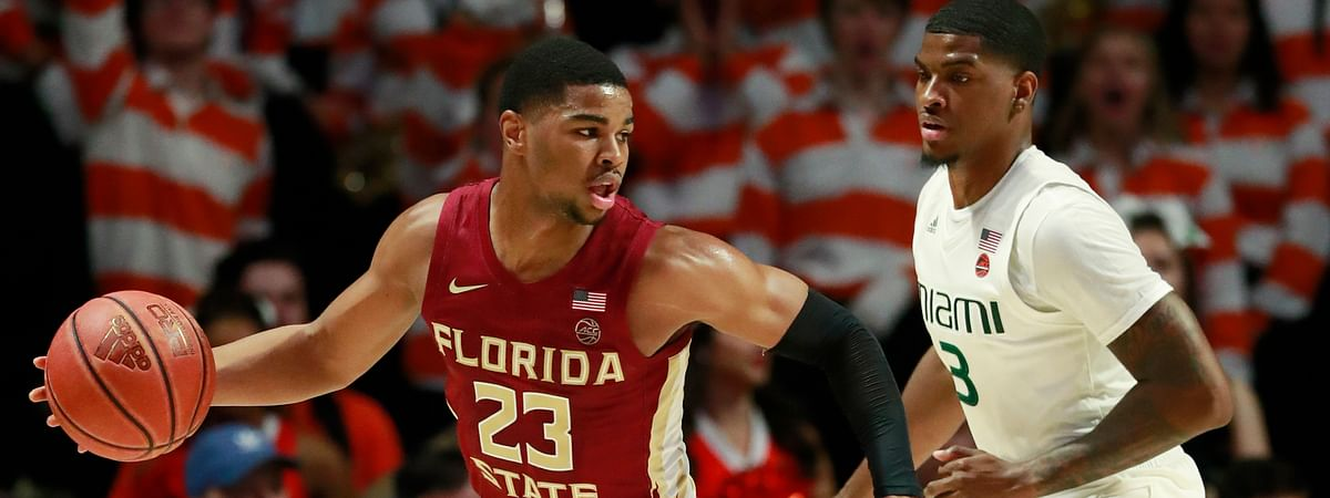 Florida State guard M.J. Walker (23) looks for an opening past Miami guard Anthony Lawrence II (3) during the first half of an NCAA college basketball game, Sunday, Jan. 27, 2019, in Coral Gables, Fla. (AP Photo/Wilfredo Lee)