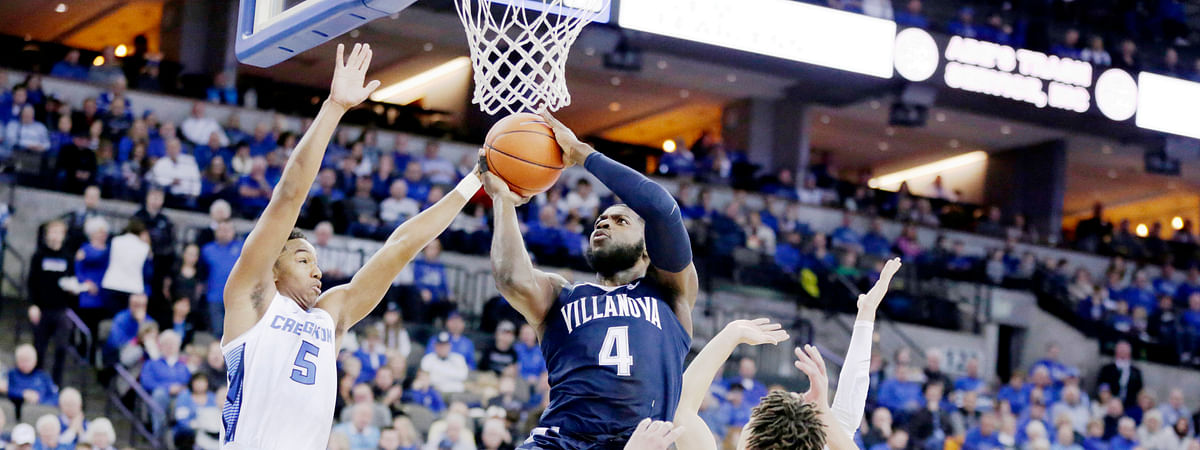 Villanova's Eric Paschall (4) goes to the basket against Creighton's Ty-Shon Alexander (5), Christian Bishop (13) and Marcus Zegarowski, rear, during the first half of an NCAA college basketball game in Omaha, Neb., Sunday, Jan. 13, 2019. (AP Photo/Nati Harnik)