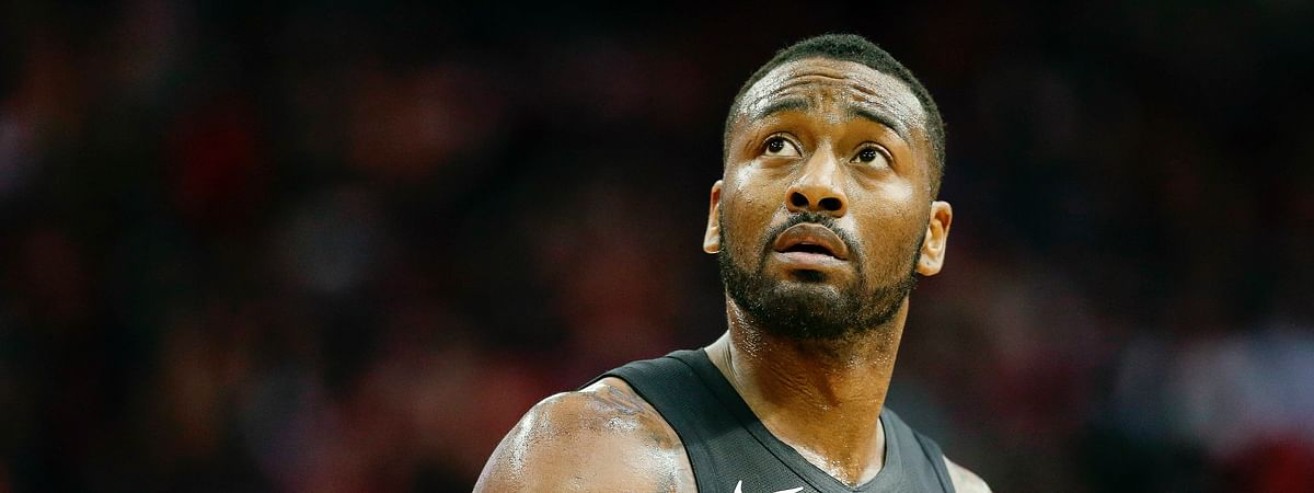 Washington Wizards guard John Wall walks off the court during a timeout during the second half of an NBA basketball game against the Houston Rockets, Wednesday, Dec. 19, 2018, in Houston. (AP Photo/Eric Christian Smith)