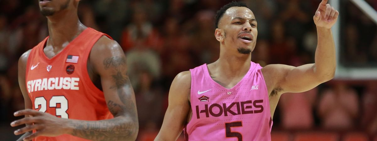 Virginia Tech's Justin Robinson points to a teammate after an assist in the second half against Syracuse in an NCAA college basketball game in Blacksburg, Va., Saturday, Jan. 26, 2019. (Matt Gentry/The Roanoke Times via AP)
