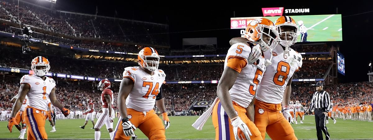 Clemson, seen here celebrating in 2019, has been hit with COVID-19 in 2020. So far no one has required hospitalization. (AP Photo/David J. Phillip)