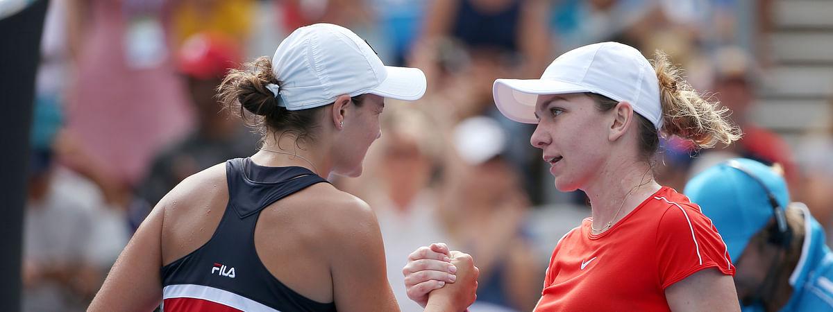 Ash Barty, left, beat Simona Halep in  Australia in January. Thursday, May 9, 2019, they meet again at the Madrid Open. (AP Photo/Rick Rycroft)